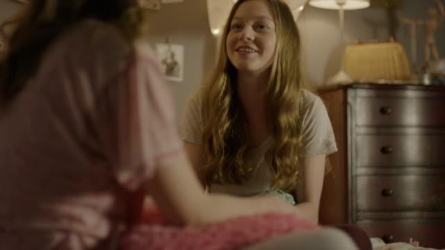 """medium shot of teenage girls talking at sleepover / cedar hills, utah, united states"" - only teenage girls stock videos and b-roll footage"