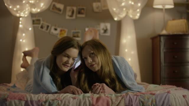 """medium shot of teenage girls talking on cell phone at sleepover / cedar hills, utah, united states"" - slumber party stock videos and b-roll footage"