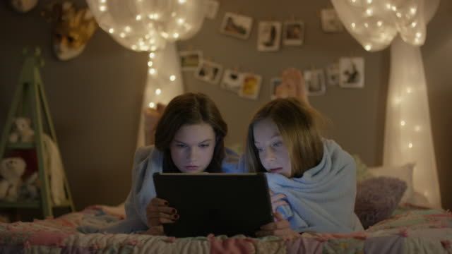 """medium shot of teenage girls watching scary movie at sleepover / cedar hills, utah, united states"" - slumber party stock videos and b-roll footage"