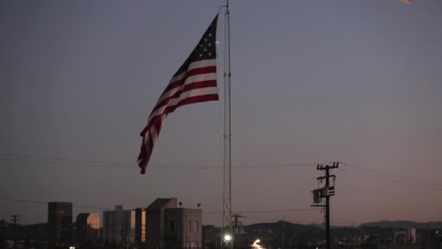 Medium Shot of the American Flag at Night