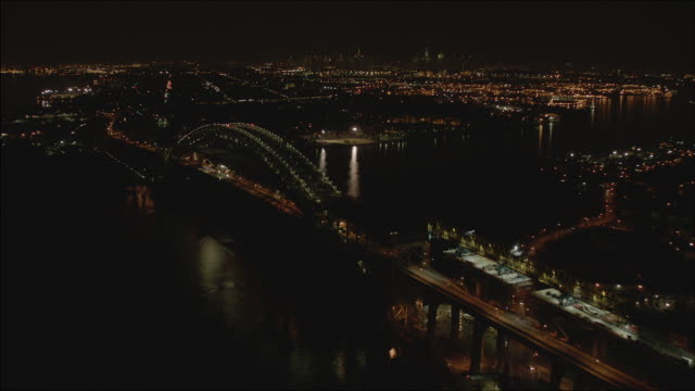 medium shot of the bayonne bridge under construction at night - sea channel stock videos and b-roll footage