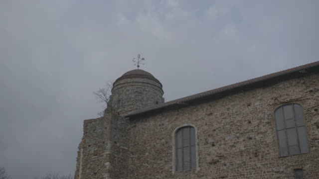 medium shot of the colchester castle with moving clouds in the background - circa 12th century stock videos & royalty-free footage
