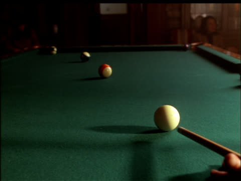 medium shot of the cue ball hitting three striped balls. - cue ball stock videos & royalty-free footage