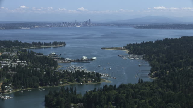 Medium shot of the Eagle Harbor with Downtown Seattle in the background