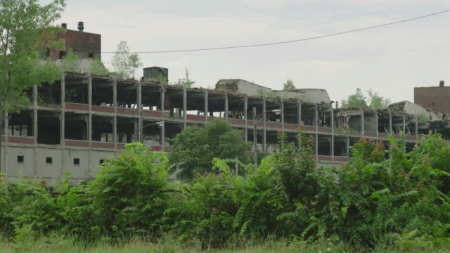 medium shot of the former packard motor car company plant - concrete stock videos & royalty-free footage