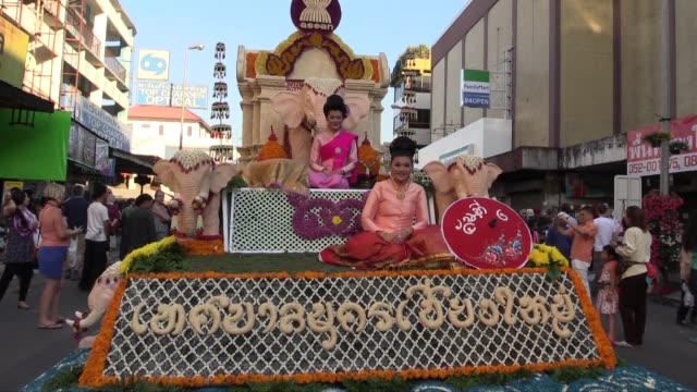 medium shot of the front of a decorated float. this is the 38th annual flower festival. - festival float stock videos & royalty-free footage