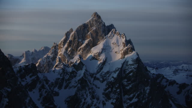 medium shot of the grand teton at sunrise - deep snow stock videos & royalty-free footage