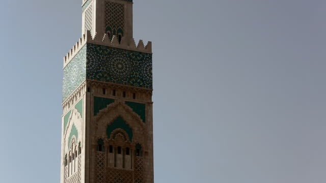 medium shot of the hassan ii mosque in casablanca - film tilt stock videos & royalty-free footage