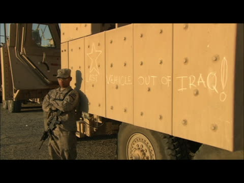 medium shot of the last us military vehicle to exit iraq on the side of the vehicle it says last vehicle out of iraq on december 18 the last us... - zuletzt stock-videos und b-roll-filmmaterial