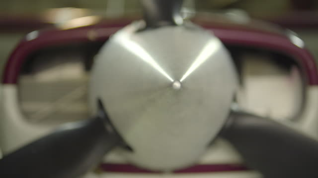 medium shot of the propeller engine of a airplane - propeller stock videos and b-roll footage