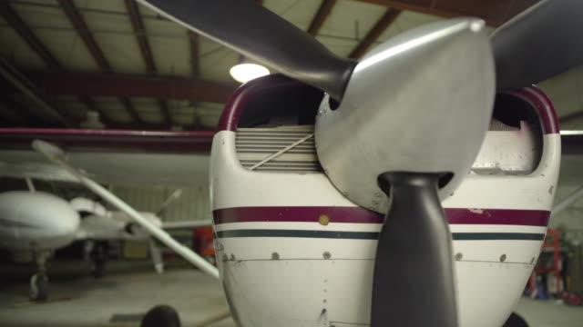 medium shot of the propeller of a airplane - propeller video stock e b–roll