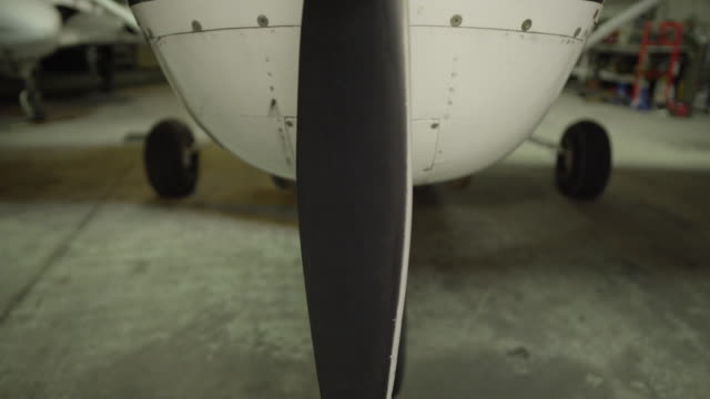 medium shot of the propeller of a airplane - propeller stock videos and b-roll footage