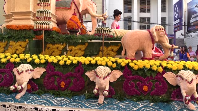 medium shot of the side of a decorated float. this is the 38th annual flower festival. - festival float stock videos & royalty-free footage