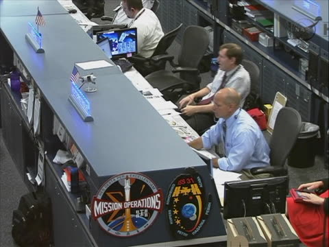 medium shot of the space station crew preparing to undock from the international space station and head back to earth - kopf nach hinten stock-videos und b-roll-filmmaterial