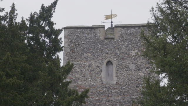 medium shot of the tower of the st martins church in canterbury - evergreen stock videos & royalty-free footage
