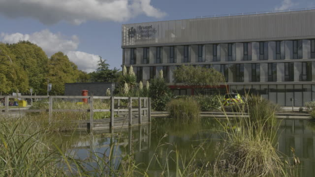 medium shot of the wilfred brown building of the brunel university london - pond stock videos & royalty-free footage