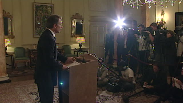 medium shot of tony blair walking up to a lectern to give a statement to the media in response to the september 11th attacks earlier in the day; 2001. - bright stock videos & royalty-free footage
