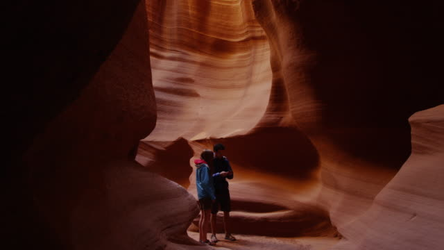 medium shot of tourist photographing canyon x / canyon x, arizona, united states,  - canyon stock videos and b-roll footage