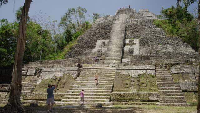 Medium shot of tourists at High Temple / High Temple, Lamani, Belize,