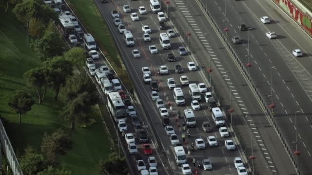 Medium Shot Of Traffic Merging Onto Freeway