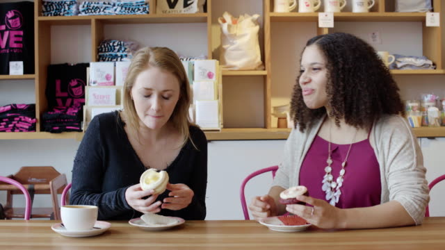 medium shot of two women eating cupcakes - cupcake stock videos & royalty-free footage