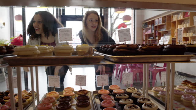 Medium shot of two women in a pastry shop