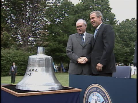 medium shot of united states president george w bush and australian prime minister john howard during a ceremony in which the bell from the uss... - war or terrorism or military点の映像素材/bロール