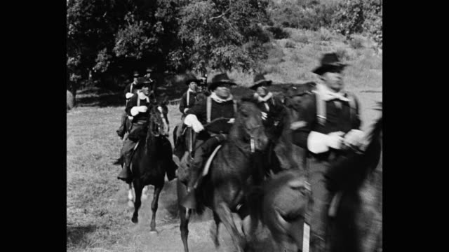 medium shot of us cavalrymen riding horses outdoors - arbeitstier stock-videos und b-roll-filmmaterial