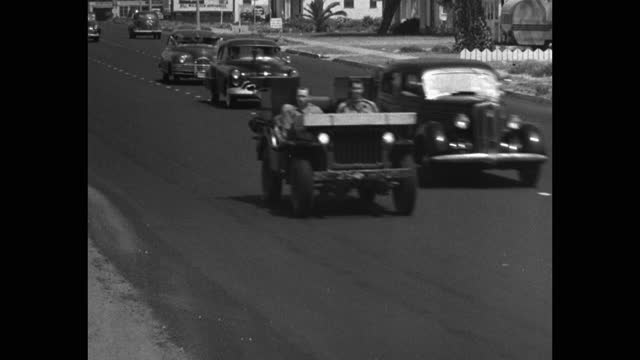 medium shot of us marines driving military jeeps on highway - 30 seconds or greater stock videos & royalty-free footage