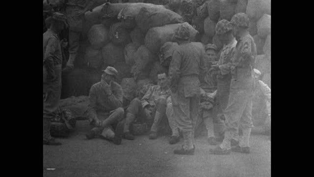 medium shot of us marines relaxing near stack of sacks at camp pendleton - medium group of people stock videos & royalty-free footage