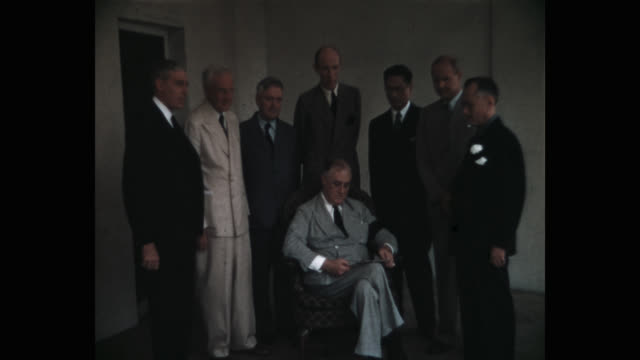 medium shot of us president franklin d roosevelt talking to cabinet members while reading document in white house washington dc usa - mid adult men stock videos & royalty-free footage