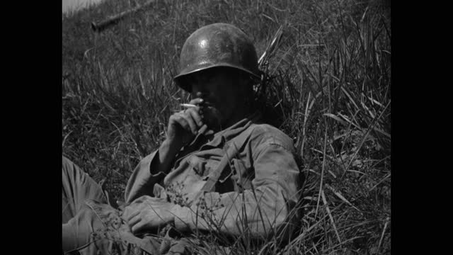medium shot of us soldier smoking cigarette on grassy hill slope - less than 10 seconds stock videos & royalty-free footage
