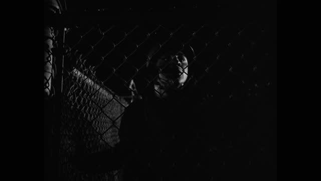 vidéos et rushes de medium shot of us soldiers cutting through fence at night - wwii pacific war reenactment - clôture