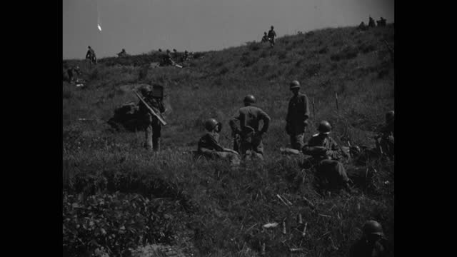 medium shot of us soldiers relaxing on grassy landscape - less than 10 seconds stock videos & royalty-free footage