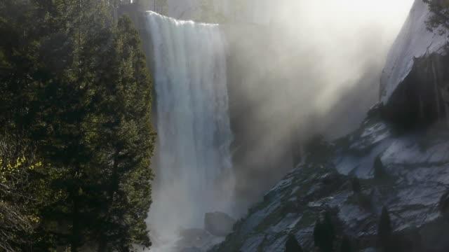 medium shot of vernal fall on the merced river in yosemite national park, california - merced fluss stock-videos und b-roll-filmmaterial