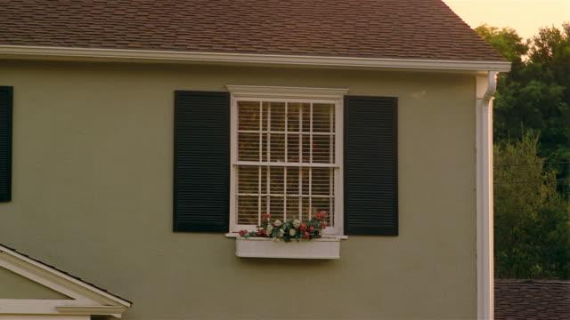 medium shot of window of suburban house with shutters and window box / santa barbara, california - window box stock videos & royalty-free footage