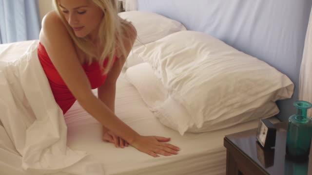 vídeos de stock, filmes e b-roll de medium shot of woman getting out of bed/marbella region, spain - plano americano