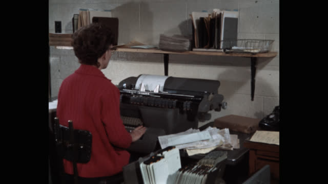 medium shot of woman working in office - only mid adult women stock videos & royalty-free footage