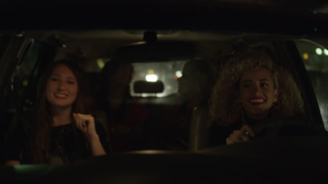 medium shot of women talking and laughing in car behind windshield / provo, utah, united states - provo stock videos & royalty-free footage