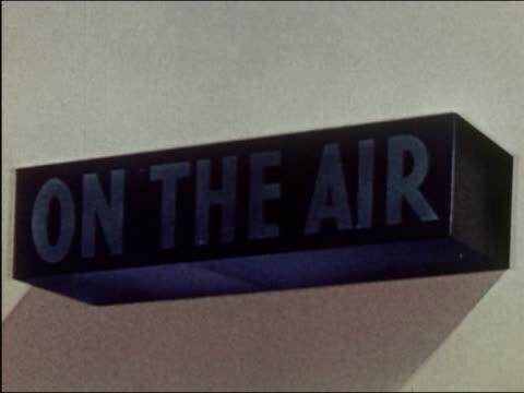 '1941 medium shot 'on the air' sign lighting up green'