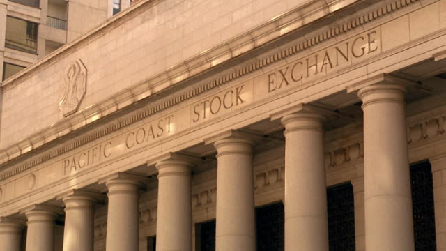 """Medium shot """"Pacific Coast Stock Exchange"""" carved on front of building / San Francisco, California"""