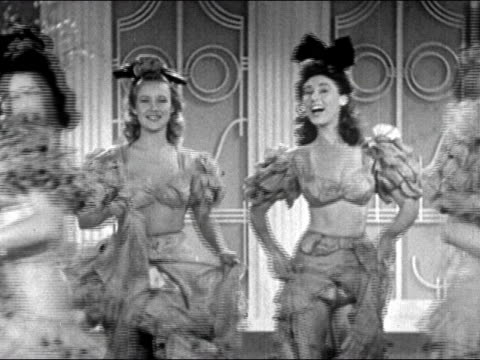 1941 medium shot pairs of showgirls dance past camera in a line/ man and woman kick and shimmy/ audio - showgirl stock videos and b-roll footage