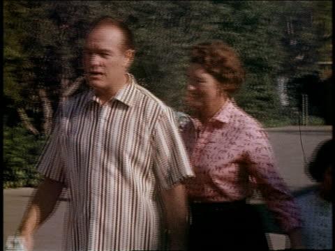 medium shot pan bob hope walking toward car w/wife and daughter - two parents stock videos & royalty-free footage