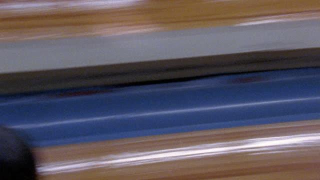 medium shot pan bowling ball rolling down bowling lane / striking bowling pins / san francisco, california - bowling ball stock videos & royalty-free footage