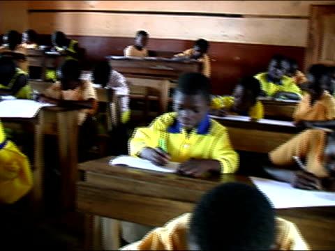 Medium shot pan children in elementary school/ Ghana