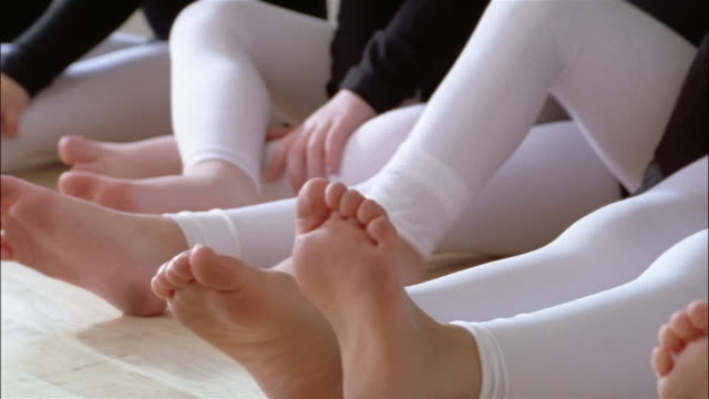 medium shot pan feet of girls wearing footless tights in ballet class - little girls bare feet stock videos and b-roll footage