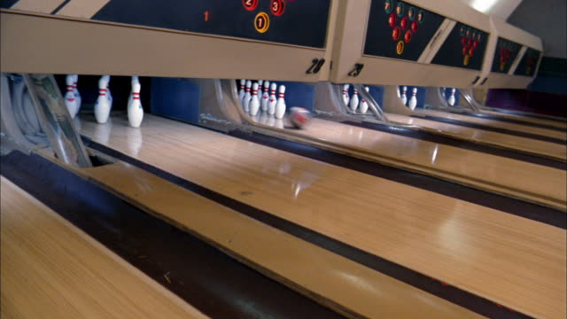medium shot pan lanes inside bowling alley - bowling alley stock videos & royalty-free footage