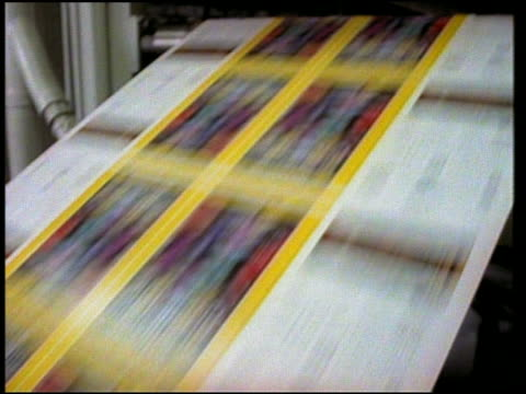 Medium shot pan magazine covers on printing press