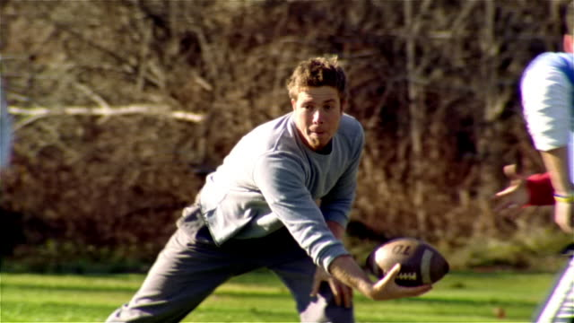 medium shot pan men and women playing football/ maine - touch football stock videos & royalty-free footage