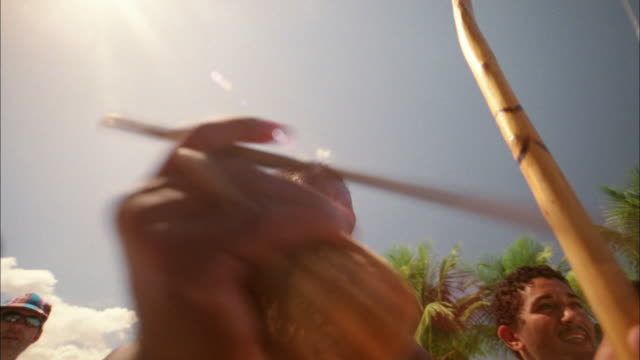 vídeos de stock, filmes e b-roll de medium shot pan musicians and percussionists performing on beach / brazil - pelo no peito
